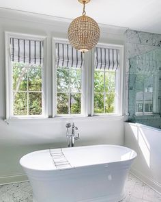 This stunning master bathroom designed by Medicine & Manicures features the Renwick light by Visual Comfort Chandelier Lighting, Bathroom Lighting, Visual Comfort, Clawfoot Bathtub, Master Bathroom, Interior, Manicures, Lighting Ideas, Medicine