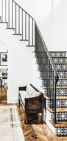 entryway featuring patterned stairway