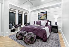 Cosy for the guestroom ! A light and neutral space and adding drama via purple furnishings.