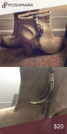Tan booties with fringe detail 4inch chunk heel, tan suede and tassel as decorative piece of zipper. Looks great with tall leg warmers and a dress. Not brand new. They have been worn a few times but no damaged. Forever 21 Shoes Ankle Boots & Booties