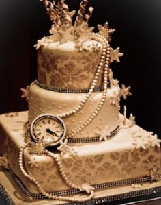 Beautiful steampunk wedding cake. not crazy on the snowflake trinkets but love the pearls and clock