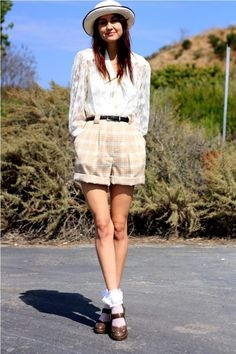 white frilly ankle socks, brown buchled pumps, ample beige checkered short, white transparent shirt