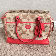 """Coral COACH bag Gorgeous COACH handbag. Zipper closure. 4 pockets inside. 13"""" length, 10"""" tall and 5"""" wide. Used 2 times. Incredibly clean! Hard to let go because it's so cute but it's better to have it go to a new home than sit in a container in the closet. :) Coach Bags"""