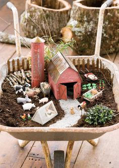Jeremie   New barnyard miniature garden with barn, silo, farm animals, veggies, chicken coop, mail box and bunny hutch.