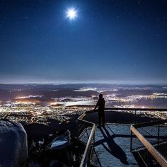 Stand atop Mount Wellington  The capital city of Tasmania, Hobart, is full of surprises – perhaps none more photographic and impressive than a trip to the Mount Wellington observation deck in the evening to admire the city from above The Absolute BEST Things to do in Tasmania (top 50)