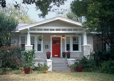 Bungalows across the nation—like this cheery example in Jacksonville, Florida—reflected Arts & Crafts principles with their low, sloping roofs and informal one-story designs. I love bungalow houses Craftsman Bungalows, Red Door House, House Styles, Exterior Design, House Painting, Bungalow Exterior, House Paint Exterior, Craftsman House, Craftsman Exterior