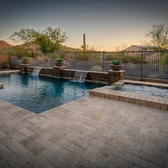 Pool with tan pavers. Water feature along pool wall. Backyard Pool Landscaping, Small Backyard Pools, Swimming Pools Backyard, Swimming Pool Designs, Backyard Ideas, Swimming Spa, Backyard Decorations, Backyard Waterfalls, Backyard Ponds