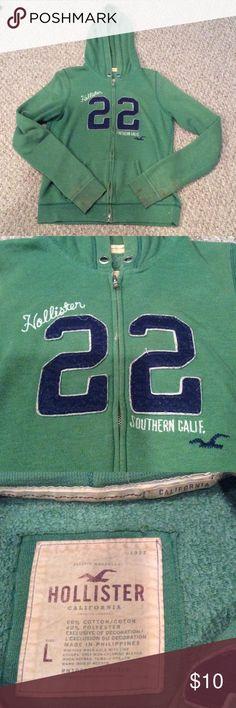 Green hollister zip up hoodie Lots of life left in this zip up hoodie.     Pet free / smoke free home 💸 make me an offer💸.  Note wear on sleeves Hollister Tops Sweatshirts & Hoodies
