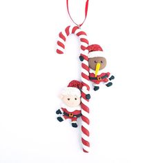 This Clay Kiwi and Lamb Santa Candy Cane Xmas Ornament will look fabulous on any Christmas tree. The candy cane decoration measures approximately Candy Cane Decorations, Kiwi Bird, Kiwiana, Xmas Ornaments, Lamb, Santa, Christmas Tree, Holiday Decor, How To Make