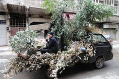 Week of Oct 18-24, 2014 Rebel fighters sit on a camouflaged pickup truck equipped with a heavy machine gun in the rebel-controlled area of al-Hajar al-Aswad, south of Damascus, on Sunday. Rami Al-Sayed/Agence France-Presse/Getty Images