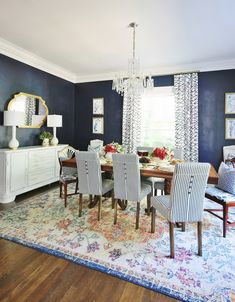 Blue and white dining room decorated for summer with blue and white striped chairs and a multi-patterned rug. Sources and a fun DIY project for the table listed on the post. Blue Dinning Room, Striped Chair, French Doors Patio, Decorating On A Budget, Room Chairs, New Homes, Dining Table, Room Decor, Living Room