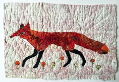 Fox. .Unframed appliqued and hand embroidered fox on to old