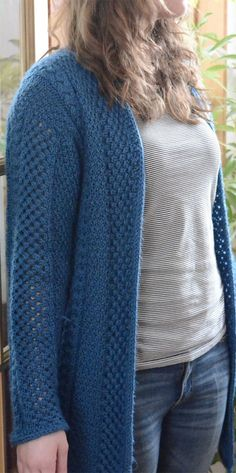 Free Knitting Pattern for 4 Row Repeat Angela's Irish Mashup - This long-sleeved cardigan features a four row repeat of 3 alternating stitch patterns: edge stitch, moss stitch, and Aran braid. Sizes S-M-L. Designed by Monica Gaucher. Aran weight yarn.