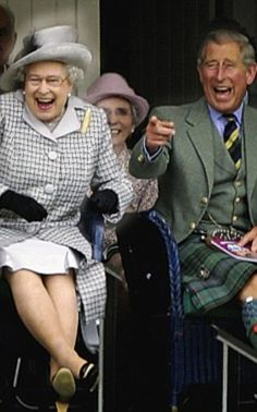 The Queen and Prince Charles laugh as they watch competitors during the Braemar Gathering in 2006, just love this photo