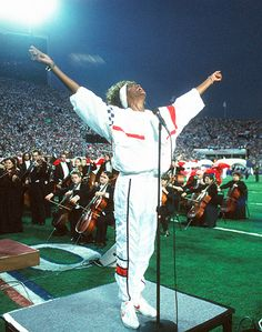 "1991 Whitney Houston (1963-2012) had another iconic moment in Tampa, Florida at the Super Bowl XXV, when she sang a rousing version of ""The Star Spangled Banner"" at the start of the Gulf War.--The greatest version ever!!!!!!!!!  Read more: http://www.usmagazine.com/celebrity-news/pictures/whitney-houston-2012112/20679#ixzz3QnfkeZKG  Follow us: @usweekly on Twitter 