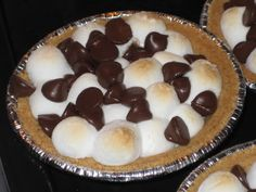 S'mores Pie...marshmallows, choc chips, tiny graham cracker crust pie shells...that's it!