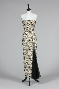 ~A Ceil Chapman black and ivory beaded guipure evening gown, 1950s, labelled, the strapless figure-hugging sheath with silkcord wrapped flowerheads, beaded pendants and chiffon kick pleat to skirt, bust 81-86cm, 32-34in, waist 56cm, 22in Provenance: Anne Dettmer collection. This gown was acquired from the Ceil Chapman estate and was made by Ceil for her daughter- in-law. photo print ad museum~