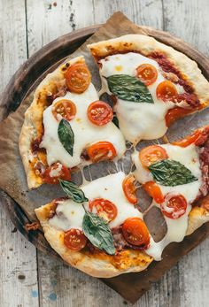 The Best Homemade Pizza Recipe - Pretty. A classic pizza made with homemade crust, quick tomato sauce, just the right amount of cheese, and your favorite toppings. Plus, many tips for m I Love Food, Good Food, Yummy Food, Delicious Recipes, Healthy Recipes, Quick Recipes, Summer Recipes, Healthy Snacks, Healthy Eating