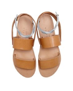 Isapera's Fokos sandal in natural is handcrafted in Greece from soft calfskin leather and features a white braided ankle strap with notch closure. Rubber sole.