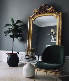 Large Baroque Mirror with a green velvet Beetle Chair by Gubi