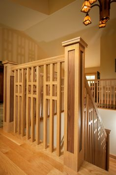 Completed custom home interior, custom wood stair railing leading to first floor. Louden Ridge, Saratoga Springs, NY