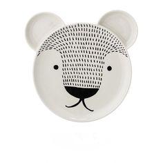 <p>Ravissante assiette en porcelaine en forme de tête d'ours avec les deux oreilles compartimentées, design Bloomingville. Pour égayer votre petit déjeuner ou vos repas ! On aime son dessin graphique et les oreilles prêtes à recevoir du ketchup ou de la moutarde .</p>