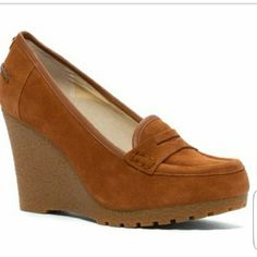 Michael Kors Wedges Michael Kors Wedges. New without tags. Never worn in great condition. Suede leather upper. Small stain inside shoe (shown in 4th pic) but does not show outside of shoe MICHAEL Michael Kors Shoes Wedges