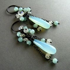 aqua chaledony, moonstone, amazonite, silver ox. Like this chicks style! Very similar to what I used to make :-)
