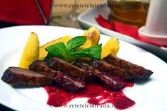 Duck breast with sour cherries sauce and roasted potatoes