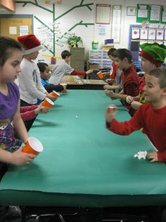 We played Minute to Win It Minute to Win It Winter Version. Kids LOVED it! First up was Snowball Toss. They simply had to toss mini marshmallows to their partner who was holding a cup.