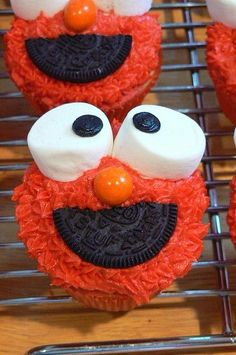 Elmo made out of a vanilla cupcake covered in red sprinkles for the base, a marshmallow for the eyes, and half an Oreo for the mouth.