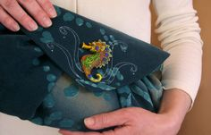 Blue handmade clutch bag with folds as waves and a seahorse