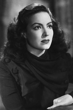"""La Doña"" María Félix sits for a portrait in 1945. lovely lady."