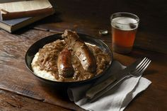 Beer-braised Bangers and Mash. Great pub fare anytime. Post menus @Chefya_ developed for the fresh-to-table trend.
