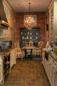 Rustic kitchen decoration using white wooden galley kitchen cabinets including dark brown limestone tile kitchen flooring and gold candle crystal glass kitchen chandeliers. Heavenly kitchen decoration with various ideas of galley kitchen cabinets Cozy Kitchen, Rustic Kitchen, Country Kitchen, Kitchen Decor, Kitchen Ideas, Narrow Kitchen, Kitchen Brick, Kitchen Dining, Rustic Farmhouse