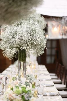 baby's breath centerpiece. Could also be in mason jars. supa cheap!