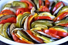Ratatouille combines the freshest of summer vegetables into one delish dish. This ratatouille recipe is artfully arranged and roasted with a light dressing.