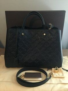 Louis Vuitton Montaigne Gm Noir Black Tote Bag. Get one of the hottest styles of the season! The Louis Vuitton Montaigne Gm Noir Black Tote Bag is a top 10 member favorite on Tradesy. Save on yours before they're sold out!