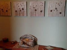 serie di quadretti fatti di semi di datteri e fili di stuoia.realizzati da Giuseppina Monni.