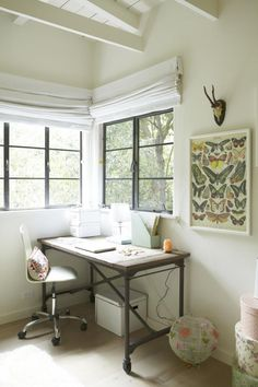 Butterfly wrapping paper (Rockett St George) framed. Good desk. Remodelista