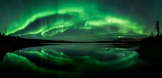https://flic.kr/p/xuSUZj | Beach Lake Aurora | 5-frame panorama This was really difficult to stitch because the lights were moving very quickly and were different in each frame.  Photoshop wouldn't even come close with auto-blend.  I really liked the reflection and I didn't think that the photo did the night justice without showing the whole lake in one image, so here is my futile attempt at a northern lights panorama over Beach Lake, Alaska.