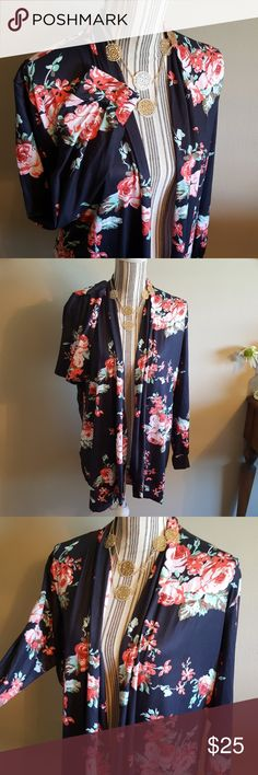 Long Floral Open Cardigan Beautiful, comfortable, and flattering, what more could you ask for?  This pretty cardigan is new without tags, I bought it from a boutique, but never wore it.  It lays very nicely on body, 85% Polyester, 15% Spandex. Tops