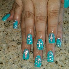 Turquoise nails with bling & crosses nailart nail designs