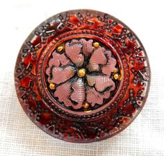 This is for one 22mm decorative Czech glass pink and orange stylized, embellished flower shank button It would make a great button for a wrap bracelet or any project you any have in mind.