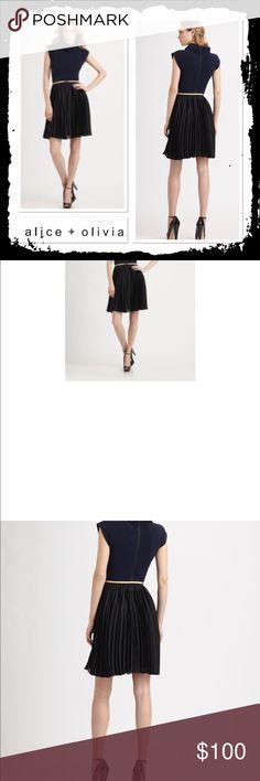 Alice + Olivia Terri Mockneck Dress Gorgeous black and navy mockneck dress with swing skirt in excellent condition Alice + Olivia Dresses