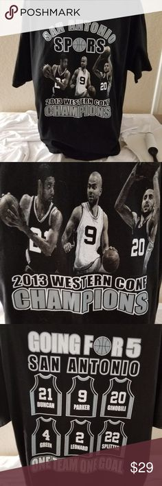 """San Antonio Spurs 2013 western Conf Champions For your consideration:  San Antonio Spurs 2013 western  Conference Champions Black T-Shirt   material 100% cotton  size 2XL  Measurement approximately:  Underarm to underarm 24""""  Sleeve 9""""  Front length 30.5""""  the tag is cut in half, however it shows the size Alstyle Shirts Tees - Short Sleeve"""
