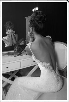 I really love Low Back Cut Wedding Dresses and her hair is wonderful too.