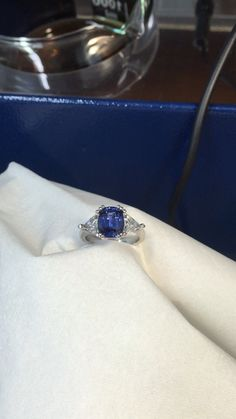 4ct Ceylon sapphire with two trillion diamond engagement ring hand made by diamondline jewellery