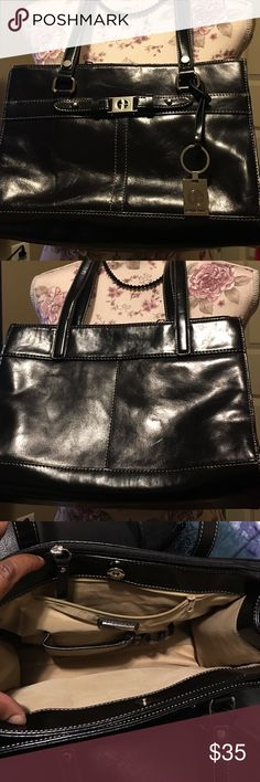 Beautiful leather black shoulder bag. This is a beautiful leather black purse with silver emblems with four compartments, inside zipper pocket, credit card slots, pen holders, cellphone pocket, and key chain holder. In very good condition like new, no odor, clean, smoke free, and no scratches or cuts, may have a mark. See pictures. Very nice! Giani Bernini Bags Shoulder Bags