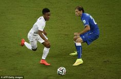 Raheem Sterling manoeuvres the ball past Italian defender Gabriel Paletta during the opening few moments of the match